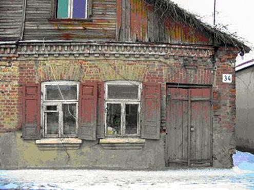 Namo Kauno g. 34 dalis, kuriame buvo įsikūrusi parduotuvė
